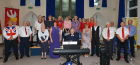 The choir with soloist Hannah Pascoe and accompanist